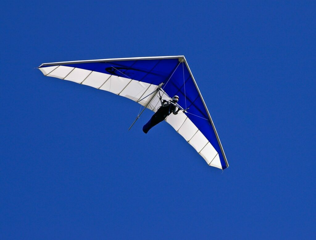 Person stepping out of his comfort zone & hang gliding